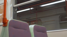 View of empty seat place in subway train, Prague, Czech Republic. View of empty seat place in subway riding train, modern clean railway carriage and then arrival stock footage