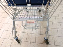 View of a empty shopping trolley in supermarket. View of a empty shopping cart in supermarket Stock Photo
