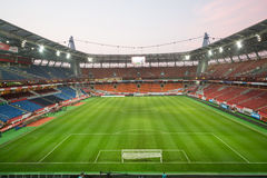 View on empty stadium with footboll field stock photos