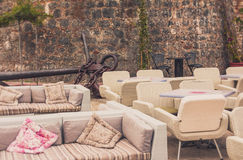 View of empty  terrace of open-air cafe with tables and chairs in old town of Budva. Montenegro. Royalty Free Stock Photos