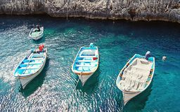 View of the empty traditional Maltese boats Luzzu. In the Blue Grotto Bay. Tourism low season concept Royalty Free Stock Image