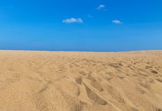 View of empty tropical beach with blue sky in sunny day Stock Image