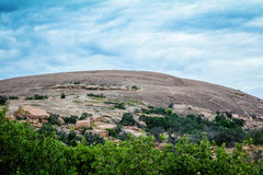 A view of Enchanted Rock. A view of the granite dome, Enchanted Rock,  at Enchanted Rock State Park outside of Fredericksburg, Texas. In the heart of the Hill Royalty Free Stock Images