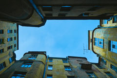 View of enclosed courtyard-well of apartment old house, view bottom Royalty Free Stock Image