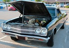 View of engine compartment of black Ford El Camino automobile. Stock Photo
