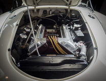 View of the engine of a white classic sports car Stock Photography