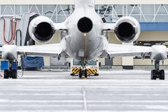 View of the engines and tail of the aircraft when push back at the airport. stock photo