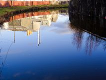 The view in an English canal reflecting its industrial past - It Royalty Free Stock Image