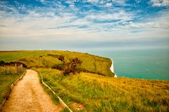 Landscape view of the White Cliffs at Dover. View of the English channel as seen from above the White cliffs of Dover. The Lighthouse is called South Foreland Stock Image