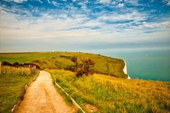 Landscape view of the White Cliffs at Dover. View of the English channel as seen from above the White cliffs of Dover. The Lighthouse is called South Foreland Stock Photo