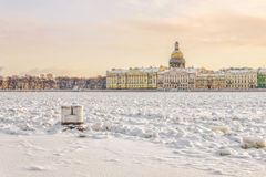 A view of the English embankment  over the frozen Neva river. Royalty Free Stock Photo