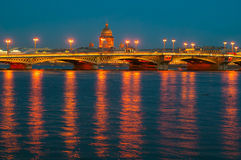 View of English embankment, St. Isaac's Cathedral and Annunciation bridge in St. Petersburg with night illumination Royalty Free Stock Photo