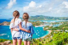 Little kids with beautiful famous view. View of English Harbor from Shirley Heights, Antigua, paradise bay at tropical Royalty Free Stock Images