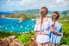Adorable little kids enjoying the view of picturesque English Harbour at Antigua in caribbean sea. View of English Harbor from Shirley Heights, Antigua, paradise Royalty Free Stock Images