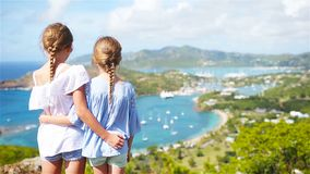 Adorable little kids enjoying the view of picturesque English Harbour at Antigua in caribbean sea. View of English Harbor from Shirley Heights, Antigua, paradise stock footage