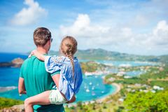 Family of dad and little kid enjoying the view of picturesque English Harbour at Antigua in caribbean sea. View of English Harbor from Shirley Heights, Antigua stock photos