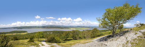 View of English Lake District. From the summit of Arnside Knott in north Lancashire with Ash tree in the foreground stock photo