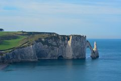 Cliffs and seaside beach in Calvados in France with this blue sky royalty free stock images