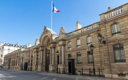 View of entrance gate of the Elysee Palace from the Rue du Faubourg Saint-Honore. Elysee Palace - official residence of stock photos