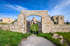 A view through the entrance gate of Panagia Kanakaria Church and Monastery in the turkish occupied side of Cyprus 2. A view through the entrance gate of Panagia royalty free stock photo