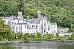 View of the entrance of Kylemore Abbey, Connemara, west of Ireland. Kylemore Abbey is a Benedictine monastery founded in 1920 on the grounds of Kylemore Castle Stock Photo