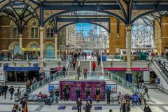 View of the entrance to Liverpool Street mainline station. Liverpool Street, London, UK - April 6, 2018: Entrance to Liverpool Street mainline station with lots Royalty Free Stock Images