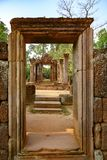 View through temple entrance in ruins of Banteay Srei, Cambodia, to the green forest.