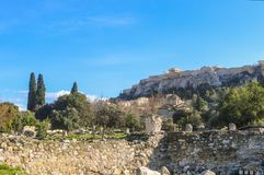 View of the Erechtheum temple dedicated to Poseidon Athena on the Accropolis in Athens Greece viewed from the ancient Agora below. View of the Erechtheum temple Royalty Free Stock Photos