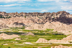 View of eroded Badlands canyons with green prairie valley Royalty Free Stock Images