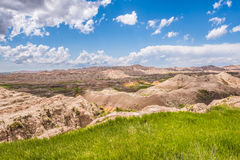 View of eroded Badlands canyons with green prairie valley Royalty Free Stock Photography