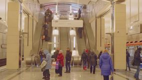 View of escalator and people on platform of new metro station Seligerskaya. In Moscow stock video
