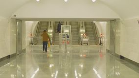 View of escalators moving up and down on metro station. In moscow stock footage