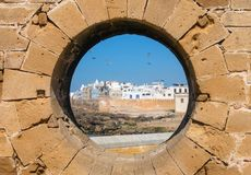 View of Essaouira through hole in wall Royalty Free Stock Image