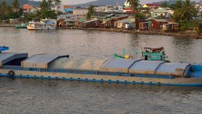 View on a estuary of a river filled with fishing boats at a sunset time. Vietnam. Phu Quoc island.  stock video footage