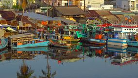 View on a estuary of a river filled with fishing boats at a sunset time. Vietnam. Phu Quoc island. City of Duong Dong stock footage