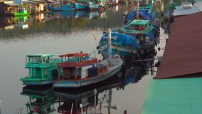 View on a estuary of a river filled with fishing boats at a sunset time. Vietnam. Phu Quoc island. City of Duong Dong stock video