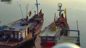 View on a estuary of a river filled with fishing boats at a sunset time. Vietnam. Phu Quoc island. City of Duong Dong stock video footage
