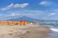 A view of the Etna volcano Sicily from the beach in Catania city Stock Image