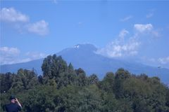 A view of the Etna volcano in Sicily, Italy. A view of the Etna volcano in Sicily a few miles from Catania, Italy. Photo taken in full day with a beautiful sun royalty free stock photos