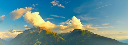 Warm evening in summer Alps,France,Europe. View of evening mountains in summer,Alps,France.Landscape of wilderness in french highland at sunset royalty free stock photos