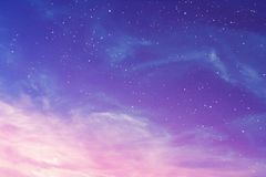 Evening purple sky with cirrus clouds and stars background, abstract