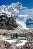 View from Everest base camp to west rock face of Nuptse peak Royalty Free Stock Photography