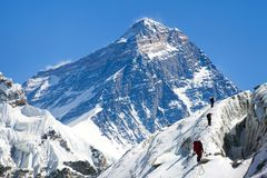 View of Everest from Gokyo valley with group of climbers Stock Image