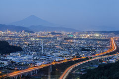 View with expressway and Mount Fuji at night time stock photos