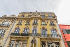 View of the exterior facade of a classic building, sky as background, in Coimbra city, Portugal. Coimbra / Portugal - 04 04 2019 : View of the exterior facade of stock photo