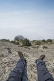 The view from the eyes of the man sitting on top of a mountain Royalty Free Stock Photos