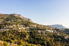 View from Eze village, trees and mountains, old houses and roads of a French Riviera. Eze, France stock photo