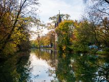 View on tower in Augsburg during autumn with water reflections royalty free stock photo