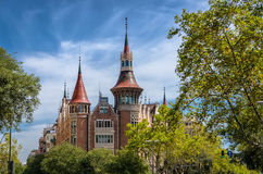 View on fabulous Casa de les Punxes in green trees and blue sky, Barcelona Spain Stock Photography