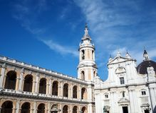 The Basilica of the Sanctuary of the Holy House of Loreto in Ita. View of the Facade of the Basilica and Bell Tower of the Sanctuary of Loreto. Marche region royalty free stock image
